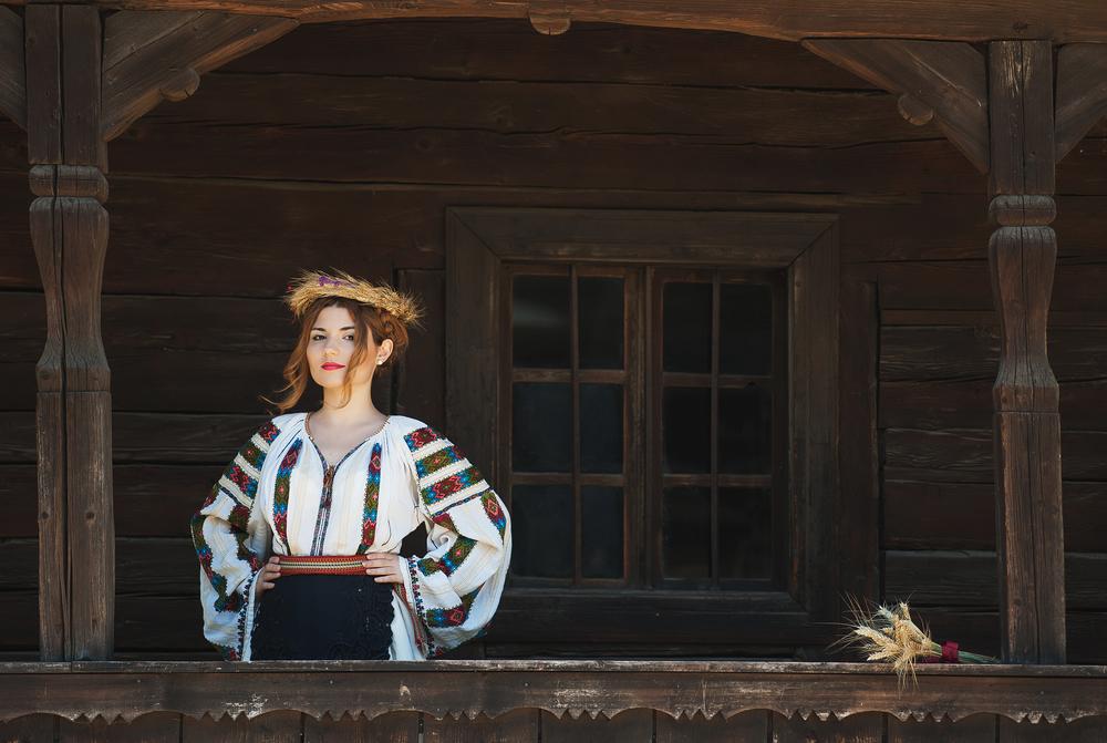 Woman posing in Romanian traditional costume