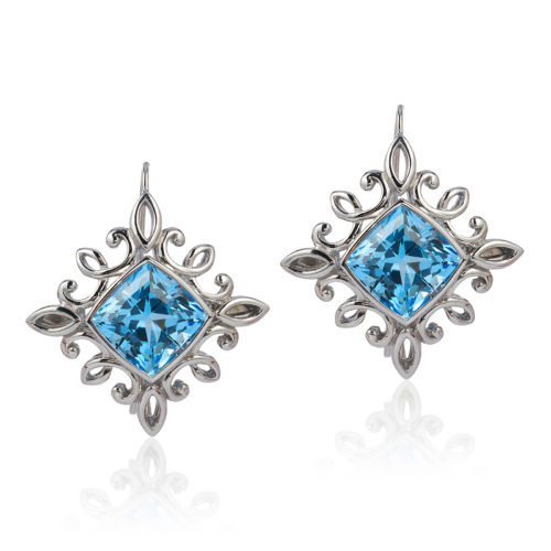 """""""Calligraphy"""" earrings in palladium featuring 17.01 carat pair of Blue Topaz; """"swan-neck"""" wires with locking backs."""