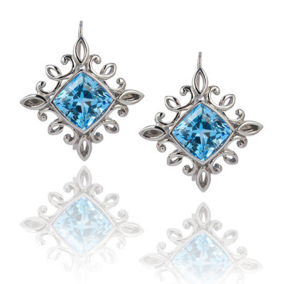 """Calligraphy"" earrings in palladium featuring 17.01 ct. pair of Blue Topaz; ""swan-neck"" wires with locking backs."