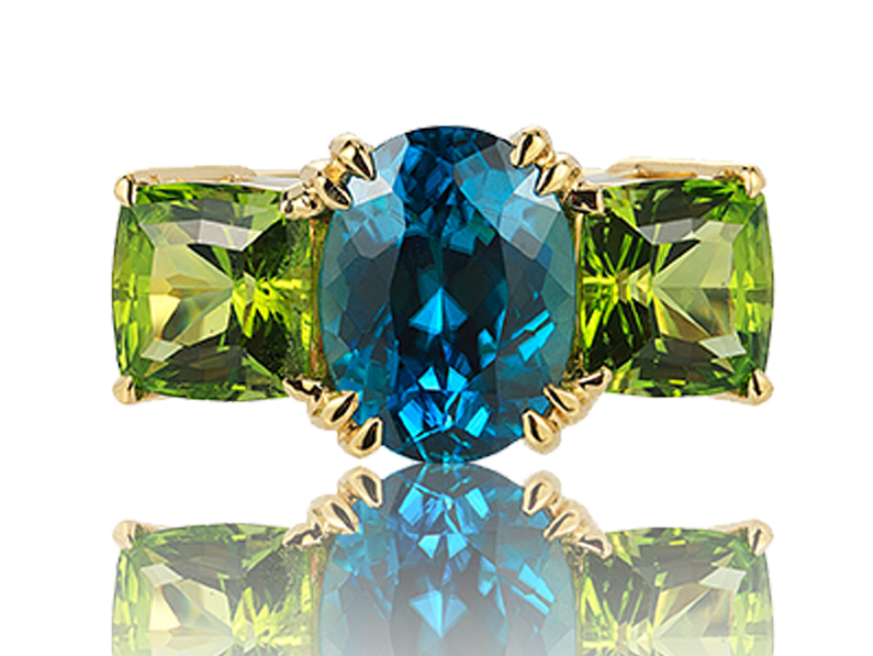18 carat yellow gold blue zircon peridot ring