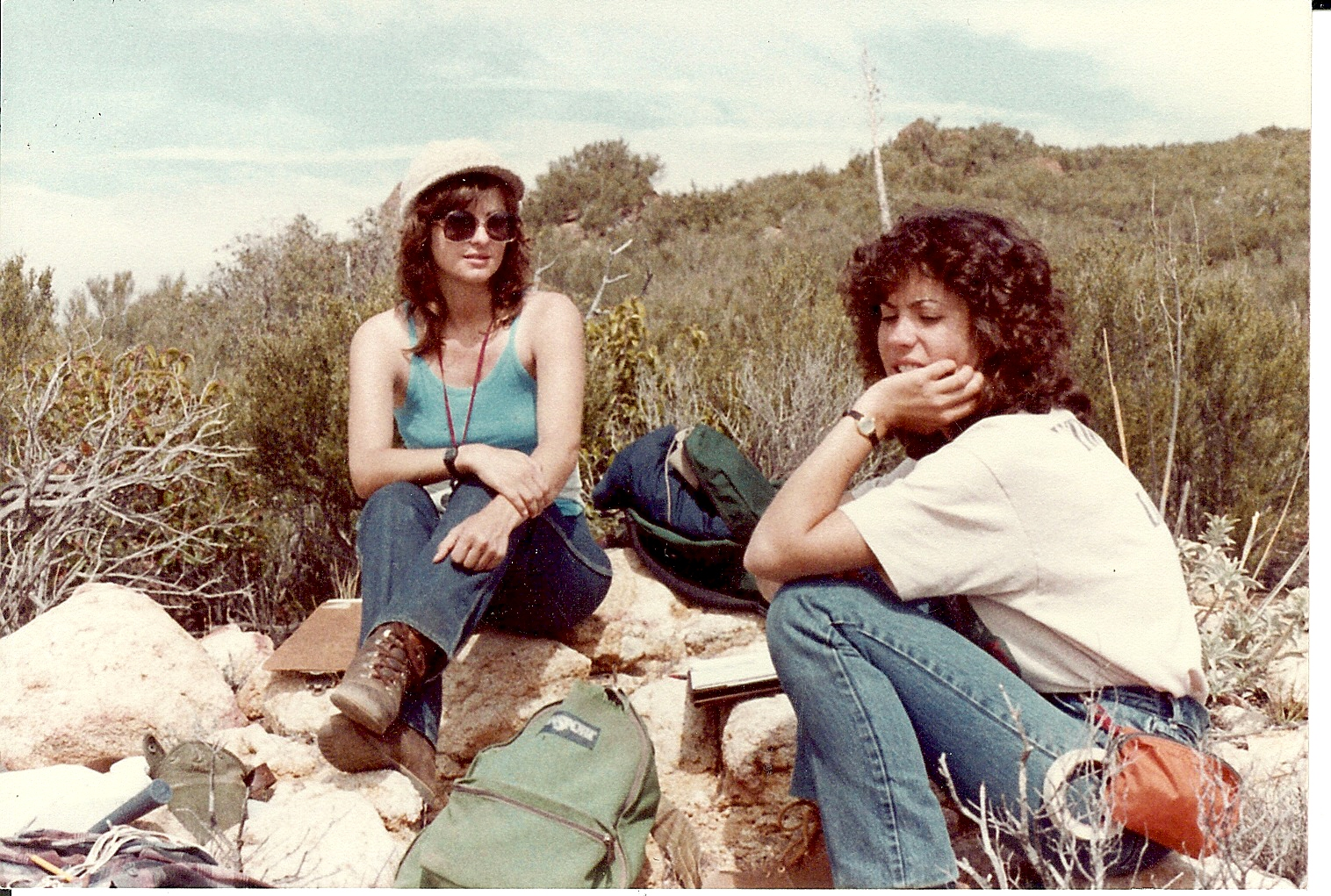 Cynthia Renee and a colleague doing field work outside San Diego among the mountains chains of molten rock