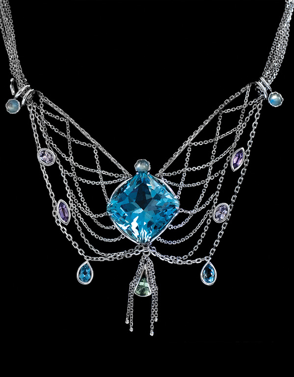 """La Mer"" ~ Cynthia Renée full custom necklace in 18-karat white gold and 14-karat white gold featuring 30.39 carat Aquamarine (Mozambique); accented by 1.25 carats of moonstone, 1.11 carats tourmaline, 0.51 carats aquamarine, 0.65 carats purple sapphire, 0.73 carats of lavender spinel. Photo by Christine Prisk"