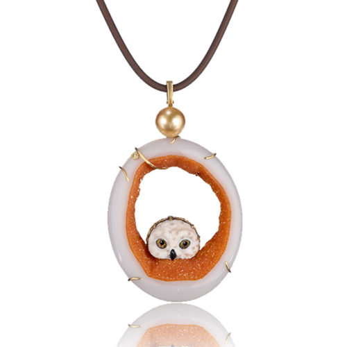 """""""Owlet Pendant"""" in 18 karat yellow gold featuring hand-carved owl head carved of white petrified palm with druzy quartz slice with 11.8 mm golden South Sea pearl; accented by one yellow diamond."""