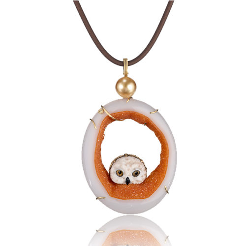 """""""Owlet Pendant"""" in 18 kt yg featuring hand-carved owl head carved of white petrified palm with druzy quartz slice with 11.8 mm golden South Sea pearl; accented by one yellow diamond."""