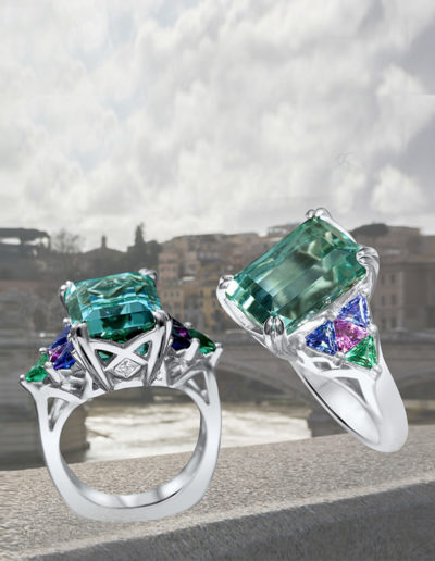 """Caribbean Quilt"" ~ Cynthia Renée full custom design ring featuring 8.94 carat Blue Tourmaline (Afghanistan, natural color), accented by a quilt of custom-cut tanzanite, pink tourmaline and emerald; two diamonds weight 0.10 carats total. Photo by Christine Prisk. <a href=""http://cynthiarenee.com/stars-arent-always-in-the-sky/""> THE STORY</a>"