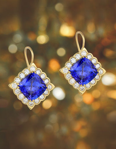 """Forever Love"" ~ Cynthia Renée full custom design 18 karat yellow gold earrings featuring 7.46 carat pair of tanzanites (Tanzania) surrounded by 1.01 carats of round diamonds. Earrings can also be worn with removable drops. Photo by Moghadam."