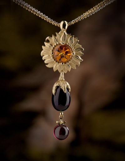 "Cynthia Renée ""Garden Patch"" pendant based on the sketch from a client's son. This garden features a buff-top Citrine ""sunflower;"" a smooth briolette Amethyst ""eggplant"" and a full-bead Rhodolite ""tomato,"" all set in 18-karat yellow gold. The sunflower portion can also be worn separately."