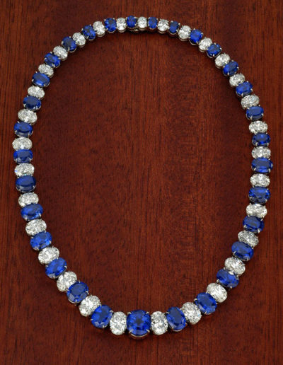 """A Garland of Blue"" ~ Cynthia Renée necklace of thirty-one, matched, unheated, Blue Sapphires (Rakwana, Sri Lanka) weighing over one hundred carats set with over forty carats of oval diamonds (predominately D-E and VS1+) in a hand-made platinum necklace of discrete design and most intricate engineering.  The project took five years from beginning to end. Seemingly simple; ultimately complex."