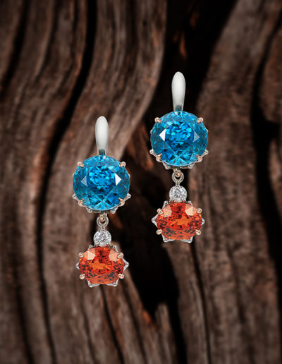 """Genius"" ~ Cynthia Renée full custom design earrings in palladium with 14 karat rose gold accent featuring 28.67 carat pair of vivid Blue Zircons (Cambodia) paired with 8.03 carats of tangerine Spessartite garnets (Namibia, natural color). The drops are removable and can be worn with other earring pieces. Photo by Moghadam. <a href=""http://cynthiarenee.com/everyones-a-genius-in-hindsight/""> THE STORY</a>"