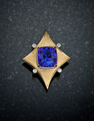 """God's Eye"" ~ Cynthia Renée full custom design multi-use brooch/necklace(s) crafted in 18 karat yellow-gold and platinum featuring 18.39 carat tanzanite. This ""God's Eye"" brooch can also be worn as a bracelet, and the remarkable tanzanite can be removed from the frame and worn as a classic pendant surrounded by diamond baguettes. Photo by Weldon."