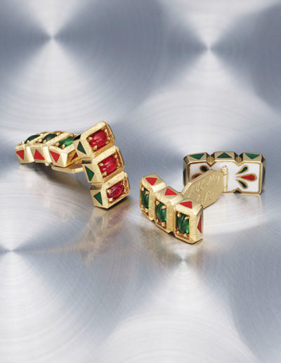 """Gold Cufflinks"" ~ Cynthia Renée custom cufflinks inspired by a vintage pair of Indian cufflinks, but updated. Six each cabochon emeralds (Colombia) and rubies (Burma) set with white enamel in 22-karat yellow gold. Cufflinks are hand-engraved, millgrained and reversible."