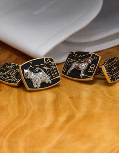 "Cynthia Renée ""Hearth and Hounds"" cufflinks made in 18-karat yellow gold, platinum, diamond and black lacquer. The cufflinks feature scenes from the owners' home and replicas of the family's Jack Russell and West Highland Terrier dogs. <a href=""http://cynthiarenee.com/hearth-hounds-cufflinks/""> THE STORY</a>"