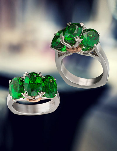 """Irish Bouquet"" ~ Cynthia Renée full custom design ring in palladium featuring trio of tsavorite garnets weighing a total of 9.63 carats; a 14 karat rose gold ribbon holds the gemstone bouquet. Winner of 2013 Spectrum Award from the American Gem Trade Association, Palladium Prestige-Classical category. Photo by Weldon."