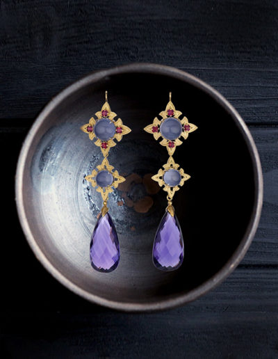 """Lastanosa"" ~ Cynthia Renée full custom design 18 karat yellow gold earrings featuring Blue Chalcedony cabochons, faceted ruby and amethyst briolettes.  Earrings are segmented and can be worn interchangeably with other Cynthia Renee earrings. Photo by Weldon."
