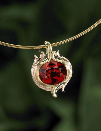 """Malaia Garnet Fireball Pendant"" ~ Cynthia Renée pendant featuring a twenty carat Malaia Garnet set in 18-karat yellow gold and 14-karat rose gold."