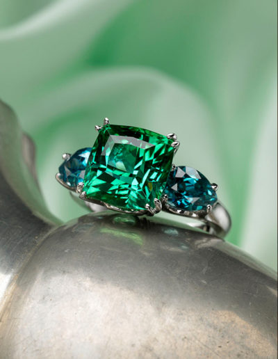 "Cynthia Renée ""Mermaid"" ring featuring 8.62 carat Afghani Tourmaline in the Zava pillow™ cut flanked by a pair of pear-shaped Blue Zircon and set in 14 karat white gold."