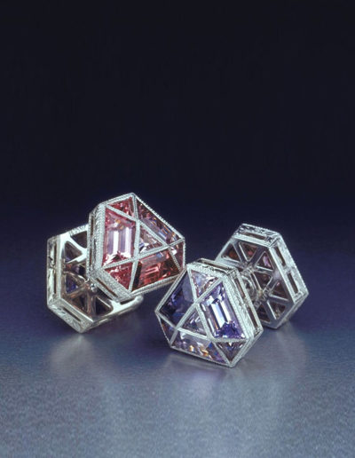 "Cynthia Renée award-winning, reversible ""Mosaic"" cufflinks featuring color varieties of Mauve and Purple/Blue Spinel from Luc Yen, Vietnam and Tanzania. Gems were set in hand-fabricated and hand-engraved platinum and cut by Clay Zava, of Zava Mastercuts. Winner of the 2001 Platinum Honors award from the American Gem Trade Association Spectrum Awards."