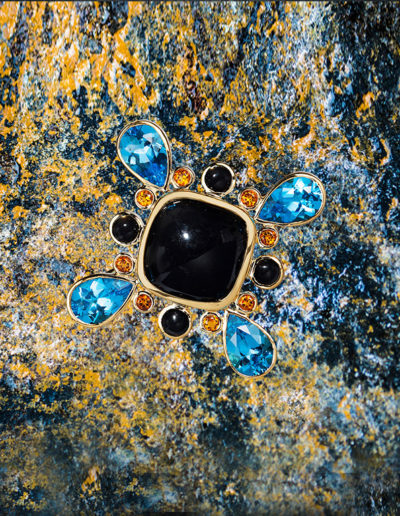 """Something New and a Bit Blue"" ~ Cynthia Renée full custom multi-use brooch/pendant in 18 karat yellow gold featuring a black onyx center accented by 13.01 carats of blue topaz; 0.77 carats of citrine and 1.95 carats of black onyx. Photo by  Mogadham.   <a href=""http://cynthiarenee.com/something-new-and-a-bit-blue-september-25-2014/""> THE STORY</a>"