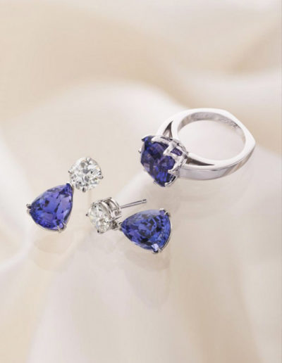 """Oprah Drops"" ~ Cynthia Renée hand-fabricated platinum earrings featuring 13.20 carat pair of Tanzanite drops in the Zava Petal™. Large round diamonds were customer's own; tanzanite drops are removable and can be used on customer's other earrings."