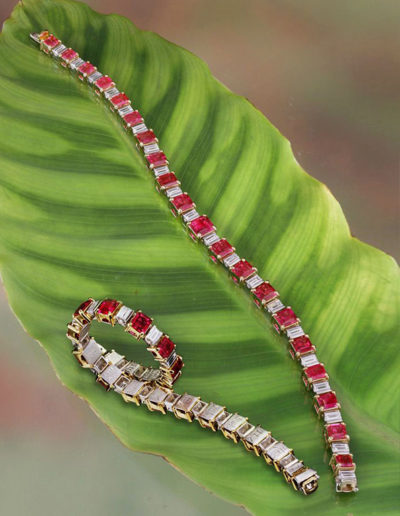 """""""Red Beryl"""" bracelet - by Cynthia Renée. Called """"probably the finest suite of American gemstones in a piece of jewelry in the world,"""" by one who knows. Twenty-one Red Beryls from Utah's Wah Wah Mountains set with 20 baguette diamonds (D-E/VS+) and set in 20-karat yellow gold and platinum. Entirely hand-made."""