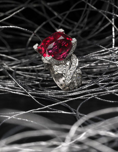 "Cynthia Renée ""Red Spinel"" ring featuring 16.25 carat Red Spinel (Tanzania) accented by 1.83 carats of diamond baguettes (E/F-VS+) and 1.54 carats of diamond rounds (E/F-VS+). The diamond baguettes extend completely around the ring and beneath the X's; setting alone took forty hours."