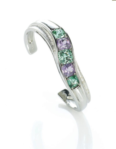 """Cuff Bracelet"" - Cynthia Renée cuff bracelet featuring suite of Zava Mastercuts' pillow™ cut gems. Gems are ""Seafoam"" Tourmaline (Afghanistan) and Purple Spinel (Umba Valley, Tanzania), set in 19-karat white gold"