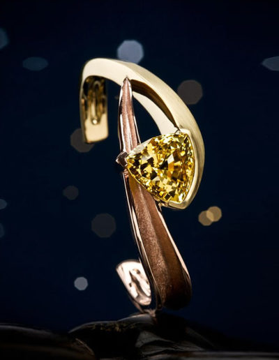 """Shooting Star"" - Cynthia Renée cuff bracelet featuring a 17 carat, unheated yellow sapphire (Sri Lanka) and set in 18-karat yellow gold and 14-karat rose gold <a href=""http://cynthiarenee.com/when-you-wish-upon-a-star/""> THE STORY</a>"