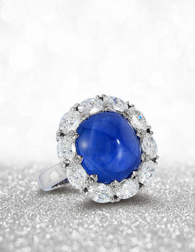 """Sugar Sweet"" ~  Cynthia Renée full custom design ring in platinum featuring a 12.35 carat blue sapphire, sugar-loaf cabochon (Sri Lanka, natural color) surrounded by 2.05 carats of oval diamonds. Photo by Moghadam."