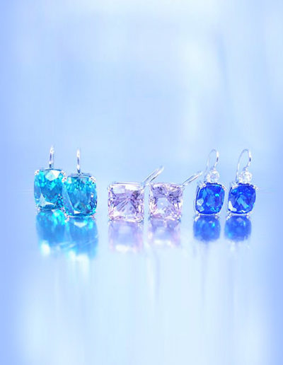 """Swan Neck""  Cynthia Renée collection of custom ""swan neck"" earrings. Left to right: Blue Zircon (Cambodia), 21.54 carats total; Pink Topaz (Pakistan), 14.56 carats total; Tanzanite (Tanzania), 8.86 carats total."