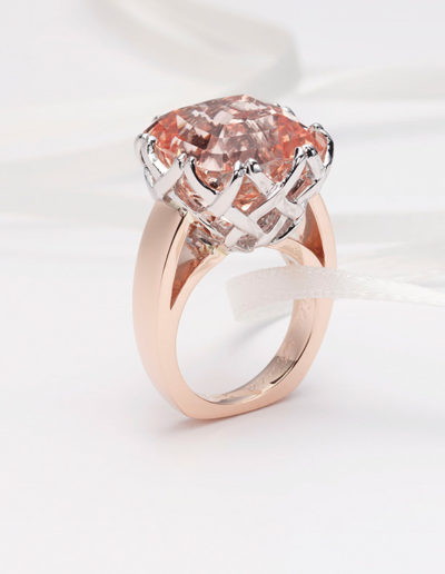 "Cynthia Renée ""Trellis"" ring featuring 18.63 carat Peach Topaz (Pakistan) in the Zava pillow™cut and set in 14 karat white and rose golds. This is our most duplicated ring and has also made featuring Yellow Sapphire, Blue Zircon, Aquamarine, Tanzanite and Morganite."
