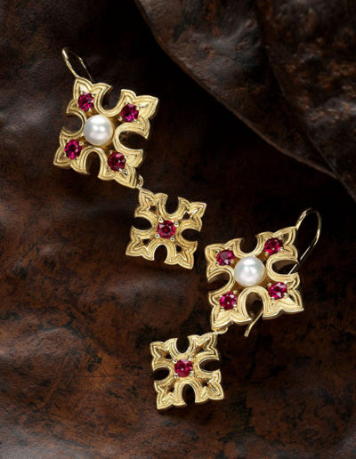 """Valentine Earrings"" ~ Cynthia Renée earrings featuring ten 3-mm round rubies weighing a total of 1.29 carats and two natural freshwater pearls in 18-karat yellow gold; bottom portion is removable. Design motif inspired by ironwork in an old Spanish church door. A pair of cufflinks were also inspired by the same church door."