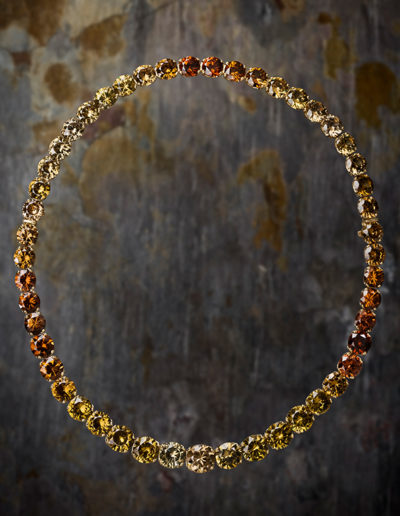 """Zircon Palette"" ~ CCynthia Renée full custom design necklace in 18-karat yellow gold featuring 49 round zircons weighing 232.79 carats or varying color. Necklace may be worn as 18 inches or as an eight inch bracelet. Photo by Jan Balster."