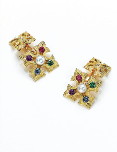 "Cynthia Renée ""Father's"" custom cufflinks made of 18-karat yellow gold. Each of the three mm gemstones represents the birth month of father and three stones; Mama is the natural, freshwater pearl in the middle. The motif was inspired by decorative studs on a Spanish church door. <a href=""http://cynthiarenee.com/fathers-cufflinks/"">MORE DETAILS</a>"