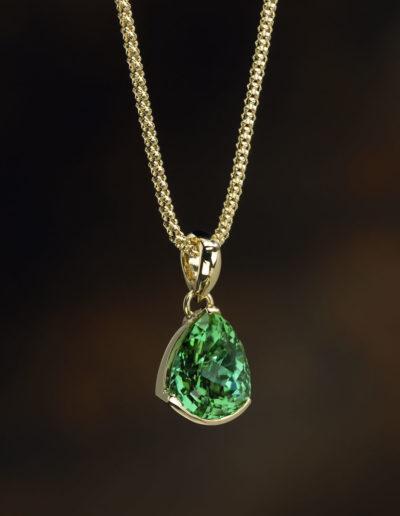 "Cynthia Renée ""Green Drop"" pendant featuring six carat Green Tourmaline (Afghanistan) in the Zava petal™ cut set in 18-karat yellow gold."