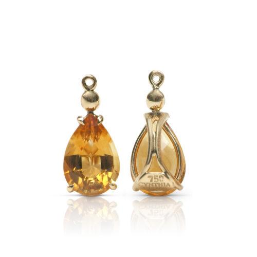 Gem drop pair in 18 karat yellow gold featuring pair of 4.69 carats pear-shape Citrine