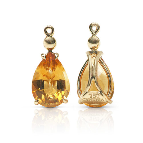 Gem drop pair in 18 karat yellow gold featuring pair of 4.69 carats pear-shape Citrine; gold sphere accent set on Citrine point.
