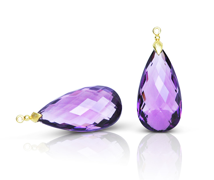 Gem Drop pair in 18 karat yellow gold featuring pair of 54.75 carats Amethyst faceted briolette; briolette cap is a hand-textured petal motif.