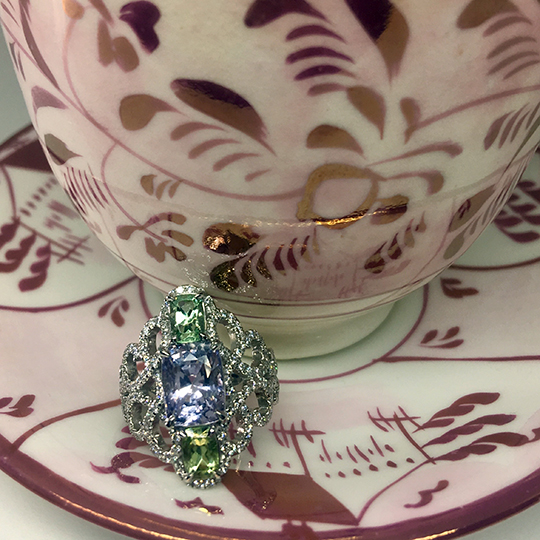 Three-stone-platinum-ring-featuring-lavender-spinel-green garnet-and-micropave-diamond-final