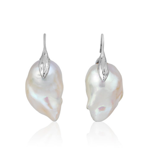 """Large and luminous white, 15x21 mm, baroque """"fireball"""" pearl earrings crafted with a leaf motif in 18-karat white gold;we make our swan-neck wire that goes through the ear shorter than most, so the earrings hang correctly and don't pull the earlobe."""