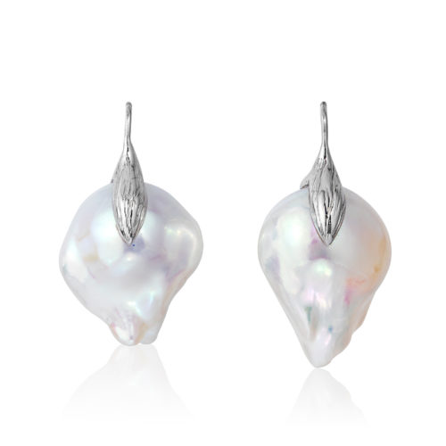 """Large and luminous white, 15x21mm, baroque """"fireball"""" pearl earrings crafted with a leaf motif in 18 karat white gold."""