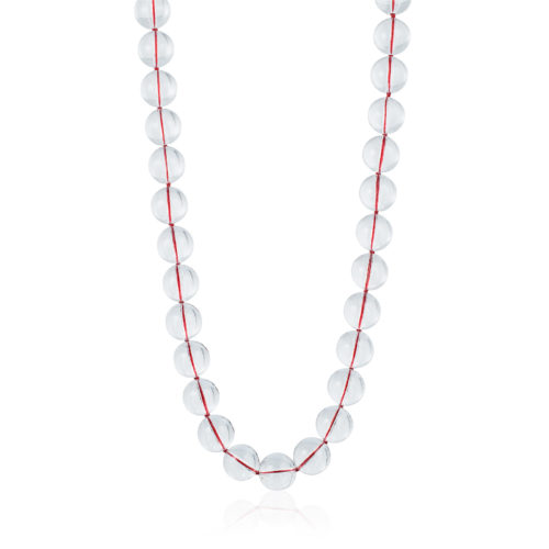 """The red thread gleams through these clear """"pools of light"""" natural quartz rock crystal beads."""