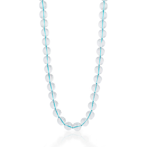 Bead necklace consisting of 38 pieces of 16-mm Rock Crystal (N) strung on knotted turquoise thread; 24 inches long.