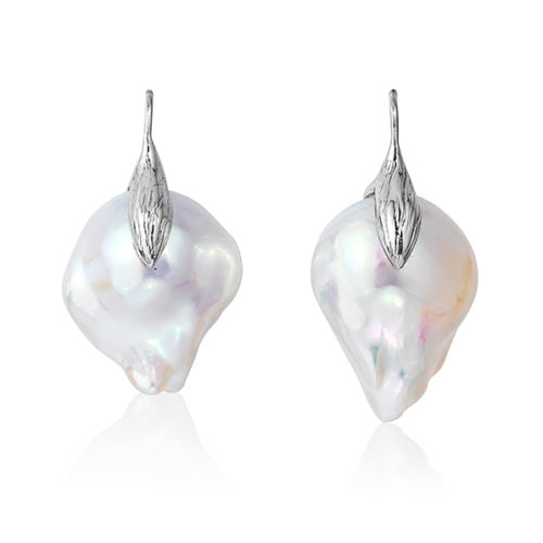 """Large and luminous white, 15x21mm, baroque """"fireball"""" pearl earrings crafted with a leaf motif in 18-karat white gold;we make our swan-neck wire that goes through the ear shorter than most, so the earrings hang correctly and don't pull the earlobe."""