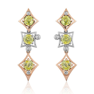 """Charmed Life"" earring in 14 karat rose and white gold featuring three pairs of Mali Garnets weighing 6.36 carats; post with large friction back; each section is removable."