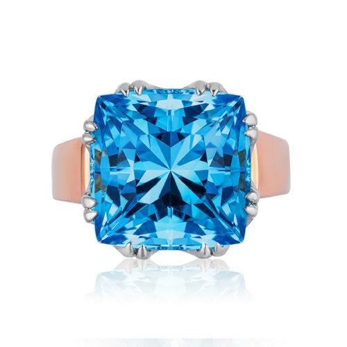 """Trellis Ring"" featuring cushion-cut 14.11 ct. Blue Topaz set in 18 kt white gold basket with 18 karat rose gold shank."