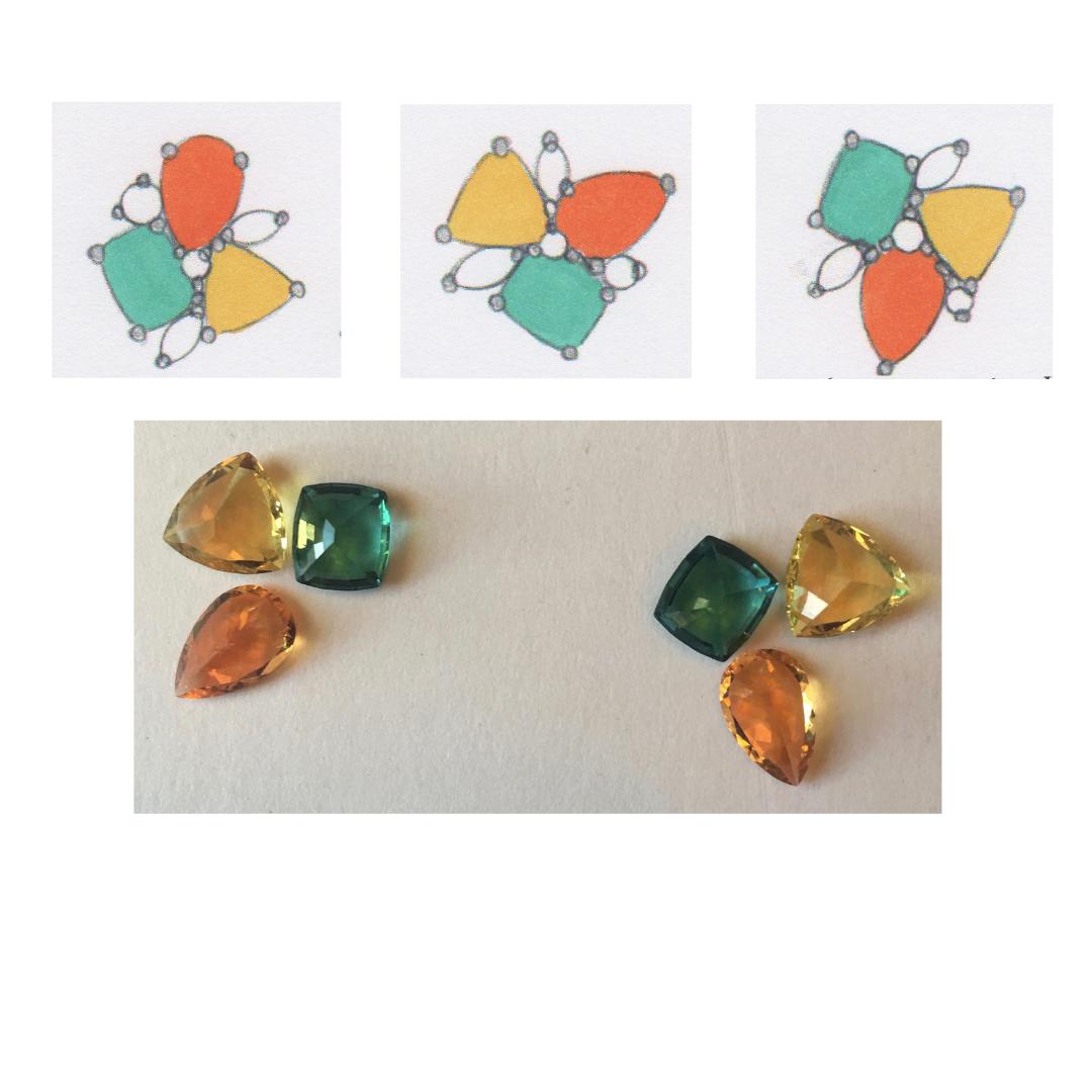 "yellow-danburite-and-teal-""cuprian""-tourmaline-and-orange-spessartite-garnet-gemstones-during-the-design-process"