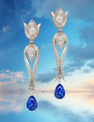 Earrings in 950 palladium featuring 6.70 carat blue sapphires and accented by 2.10 carats round diamonds by Cynthia Renee