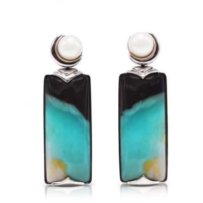 """Crescent"" earrings in 18 karat white gold featuring 26.52 carats pair of natural Opalized Wood and a pair of 7-7.5 mm Freshwater Pearl; the opalized wood is found in the West Java Province of Indonesia."