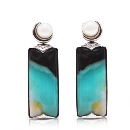 """""""Crescent"""" earrings in 18 karat white gold featuring 26.52 carats pair of natural Opalized Wood and a pair of 7-7.5 mm Freshwater Pearl; the opalized wood is found in the West Java Province of Indonesia."""