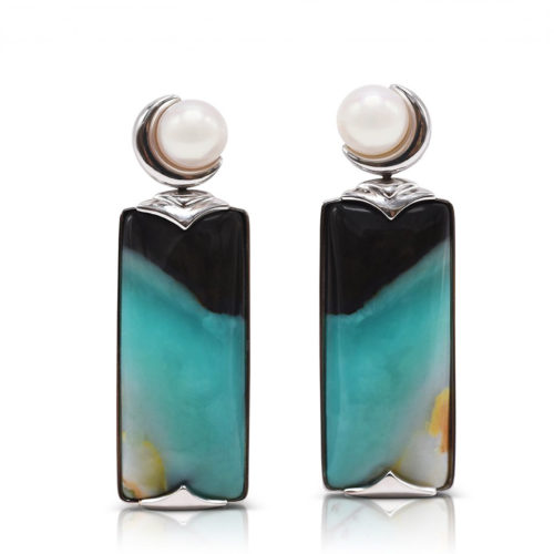 """""""Crescent"""" earrings in 18 karat white gold featuring 29.12 carats pair of natural Opalized Wood and a pair of 7-7.5 mm Freshwater Pearl; the opalized wood is found in the West Java Province of Indonesia."""